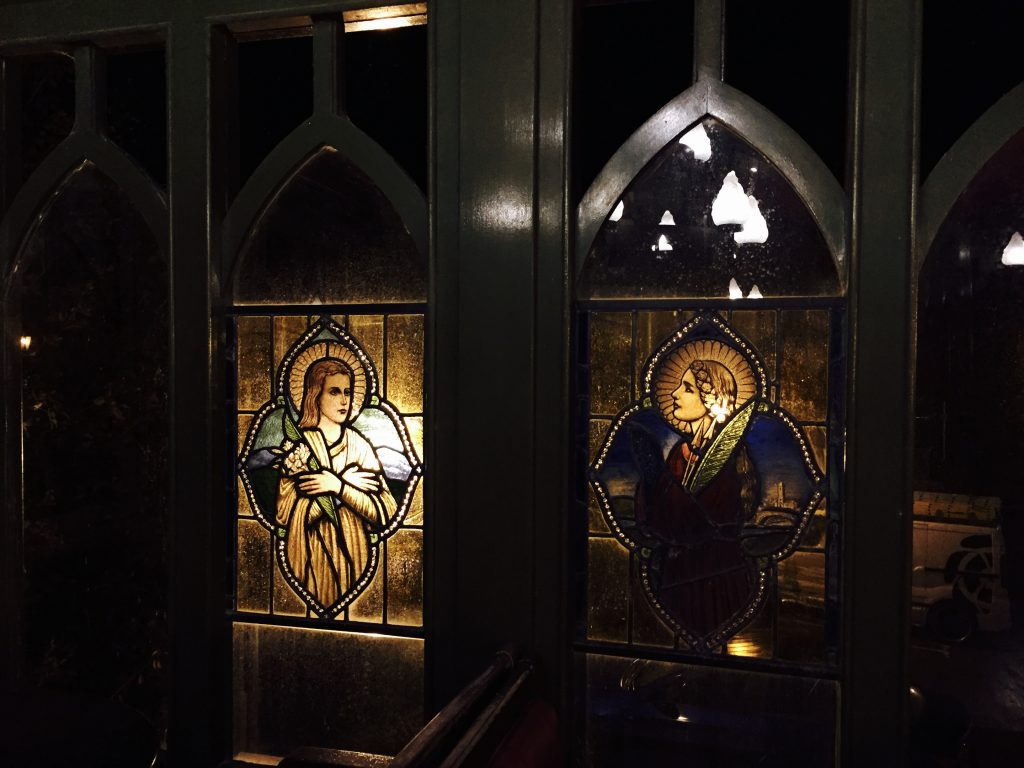 A photo of stained glass windows at Crawfordsburn Inn, N. Ireland for the poem The Crawfordsburning - by Angela Josephine